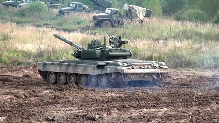 troop : Moscow region, Russia - 27 August 2017: Military tank for strikeball. Russian fun. Forum army 2017. Games for men. People against war. Stock Footage