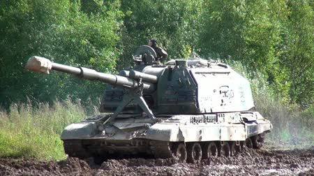 gyalogosok : Moscow region, Russia - 27 August 2017: Military tank for strikeball. Russian fun. Forum army 2017. Games for men. People against war. Stock mozgókép