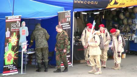troop : Moscow region, Russia - 27 August 2017: Squad of strikeball team with machine submachine guns. Russian fun. Forum army 2017. Games for men. People against war. Stock Footage