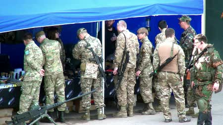 tropas : Moscow region, Russia - 27 August 2017: Squad of strikeball team with machine submachine guns. Russian fun. Forum army 2017. Games for men. People against war. Stock Footage