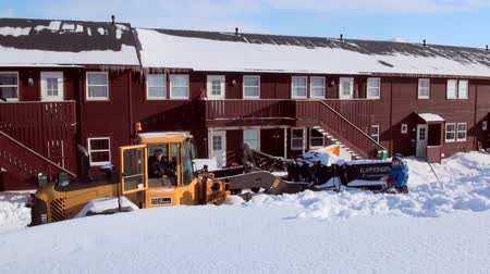 mines : LONGYEARBYEN, SVALBARD - 23 APRIL, 2015: Landscape and buildings, roads in Small town Longyear among snow capped mountains of Norwegian archipelago of Svalbard in early spring in Norway.