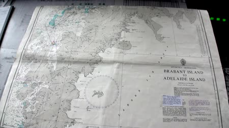 antarktyda : Antarctica - 10 January 2015: Geographical map Brabant Island on research ship vessel of Antarctica Ocean. Unique landscape of nature. Wildlife on background of white snow coast desert.