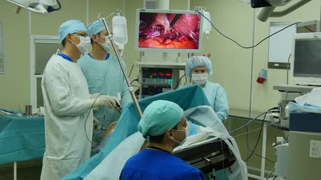 sebész : Moscow, Russia - 16 September 2016: Abdominal laparoscopy on professional medical equipment in operating room. Professional work of surgeon doctor.
