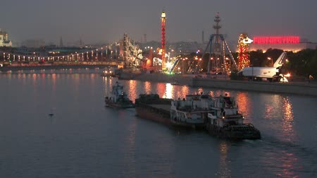 este : Moscow, Russia - 16 August 2010: Barges are floating along the river in evening. Beautiful views of capital at sunset. Arched steel construction in big city.