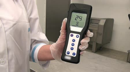 disinfectant : Moscow, Russia - 20 May 2016: Lumenometer test in food industry. Hand of worker during the bacteriological study. Application of disinfectant solution. Stock Footage