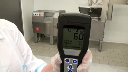 supermarket food : Moscow, Russia - 20 May 2016: Lumenometer test in food industry. Hand of worker during the bacteriological study. Application of disinfectant solution. Stock Footage