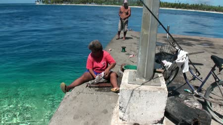 after fire : Tahiti Island French Polynesia - 26 May 2018: Fish is fried on charcoal fire. Cooking food after fishing. Eating out in the open air. Stock Footage