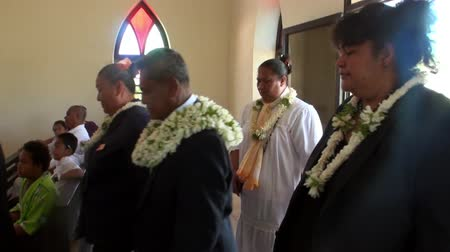 chant : Tahiti Island French Polynesia - 26 May 2018: People in Church TIONA. Believers sing prayers.