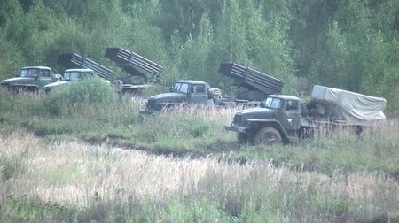 rocket launcher : Moscow region, Russia - 27 August 2017: Military BM-21 combat vehicle of the M-21 field reactive system. Missile launcher Grad on background of forest. Stock Footage