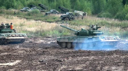 rocket launcher : Moscow region, Russia - 27 August 2017: Military BM-21 combat vehicle of the M-21 field reactive system. Tank rides near missile launcher Grad on background of forest.