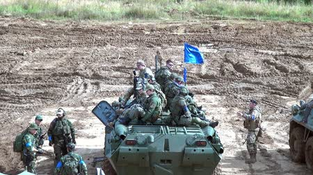 troop : Moscow region, Russia - 27 August 2017: Squad of strikeball team with machine submachine guns on panze. Russian fun. Forum army 2017. Tanks are not afraid of dirt. Games for men. People against war.