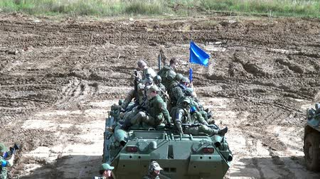 tropas : Moscow region, Russia - 27 August 2017: Squad of strikeball team with machine submachine guns on panze. Russian fun. Forum army 2017. Tanks are not afraid of dirt. Games for men. People against war.