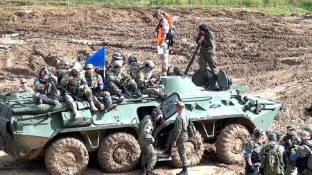 войска : Moscow region, Russia - 27 August 2017: Squad of strikeball team with machine submachine guns on panze. Russian fun. Forum army 2017. Tanks are not afraid of dirt. Games for men. People against war.
