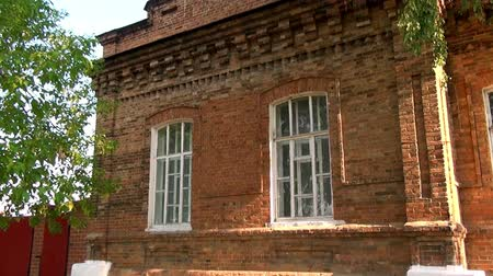 paley : Alapaevsk, Russia - 17 July 2012: Windows of museum of Remembrance of Representatives of Russian Imperial House. Building, which contained relatives of Nicholas II before their execution.