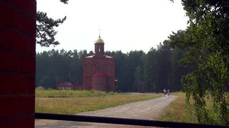haldokló : Alapaevsk, Russia - 17 July 2012: Monastery of the New Martyrs and Confessors of Russia. Building is located on spot where on July 18, 1918 Elizaveta Romanova and princes were dumped alive in mine. Stock mozgókép