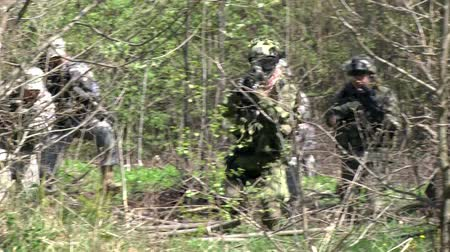 combate : Moscow, Russia - May 09, 2013: People in uniform on background of military hand grenade explosion in forest. Impact strength and power of weapon.