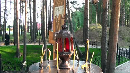 governor : Alapaevsk, Russia - 17 July 2012: Candles near cross with crucifix in place of execution of Elizabeth Feodorovna. History of last days of life of relatives of Russian Emperor Nicholas II Romanov.