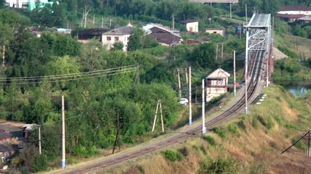 romanov : Alapaevsk, Russia - 17 July 2012: Church in small city in Urals on background of railway and river.