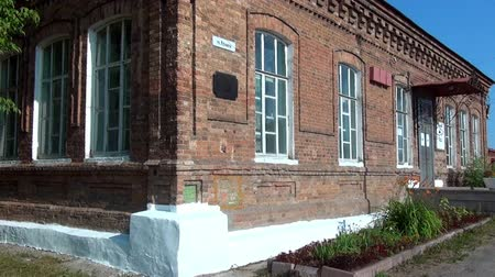 governor : Alapaevsk, Russia - 17 July 2012: Windows of museum of Remembrance of Representatives of Russian Imperial House. Building, which contained relatives of Nicholas II before their execution.