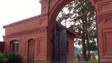 çöküş : Alapaevsk, Russia - 17 July 2012: Gate of monastery of New Martyrs and Confessors. Building is located on spot where on July 18, 1918 Elizaveta Romanova and princes were dumped alive in mine.