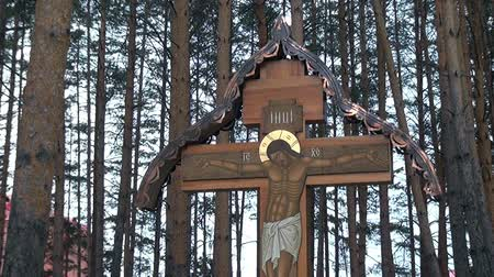 crucifix : Alapaevsk, Russia - 17 July 2012: Cross with crucifix in place of execution of Elizabeth Feodorovna. History of last days of life of relatives of Russian Emperor Nicholas II Romanov.
