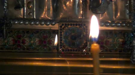 mumlar : Alapaevsk, Russia - 17 July 2012: Candles burn before icon of Saint Elizabeth in monastery of New Martyrs. Religious relic is located in building on site of executions of Elizabeth Feodorovna.