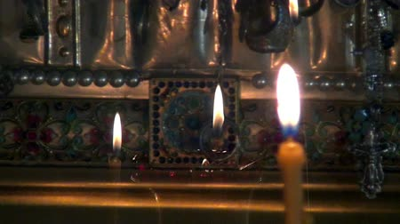 romanov : Alapaevsk, Russia - 17 July 2012: Candles burn before icon of Saint Elizabeth in monastery of New Martyrs. Religious relic is located in building on site of executions of Elizabeth Feodorovna.