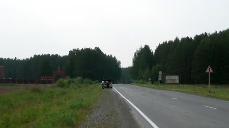 haldokló : Alapaevsk, Russia - 17 July 2012: Road to monastery of New Martyrs and Confessors. Building is located on spot where on July 18, 1918 Elizaveta Romanova and princes were dumped alive in mine.