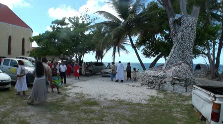 seashell : Tahiti Island, French Polynesia - 26 May 2018: People near religious tree with seashells. Stock Footage