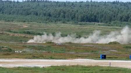 tropas : Alabino, Russia - 22 August 2017: Military tank rides across field in background of forest at the Army Forum 2017.