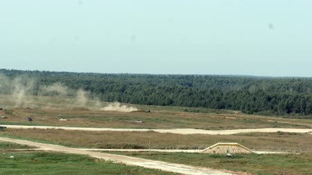 troop : Alabino, Russia - 22 August 2017: Military tank rides across field in background of forest at the Army Forum 2017.