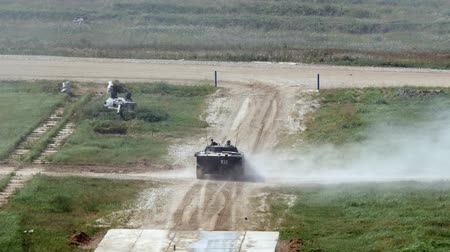 tropas : Alabino, Russia - 22 August 2017: Russian military tank rides on road and shoots at Army Forum 2017. Special combat equipment with a firearm.