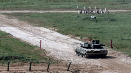 submachine : Alabino, Russia - 22 August 2017: Russian military tank stands on road and shoots at Army Forum 2017. Special combat equipment with a firearm.