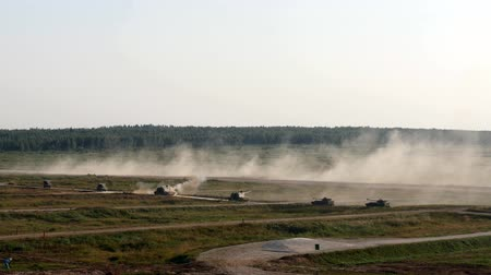 armado : Alabino, Russia - 22 August 2017: Military tanks stand in row and shoot at Army Forum 2017. Special combat equipment with a firearm on background of forest. Stock Footage