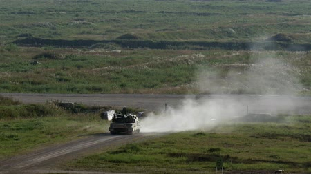 tropas : Alabino, Russia - 22 August 2017: Military tank stands on road and shoots at Army Forum 2017. Special combat equipment with a firearm.