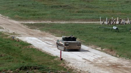 troop : Alabino, Russia - 22 August 2017: Russian military tank rides on road and shoots at Army Forum 2017. Special combat equipment with a firearm.