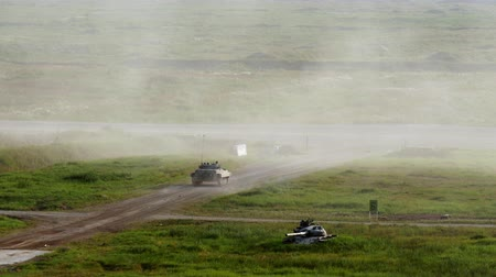 armado : Alabino, Russia - 22 August 2017: Russian military tank rides on road and shoots at Army Forum 2017. Special combat equipment with a firearm.