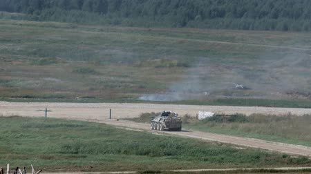 tropas : Alabino, Russia - 22 August 2017: Russian military fighting machine rides on road on background of forest. Special combat equipment with a firearm at Army Forum 2017.