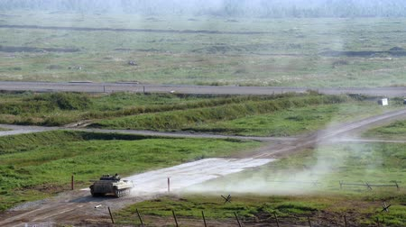 standlar : Alabino, Russia - 22 August 2017: Russian military tank stands on road and shoots at Army Forum 2017. Special combat equipment with a firearm.