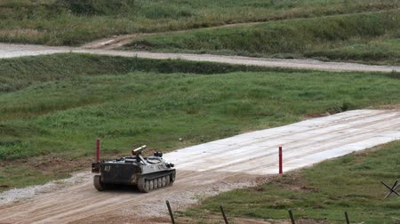 tropas : Alabino, Russia - 22 August 2017: Russian military tank stands on road. Special combat equipment with a firearm.