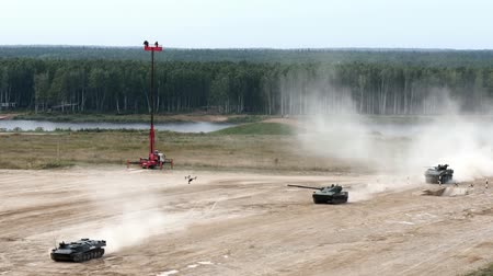 submachine : Alabino, Russia - 22 August 2017: Russian military fighting machine rides on road on background of forest. Special combat equipment with a firearm at Army Forum 2017.