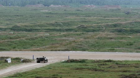 troop : Alabino, Russia - 22 August 2017: Russian military fighting machine stands on road and shoots at Army Forum 2017. Special combat equipment with a firearm.