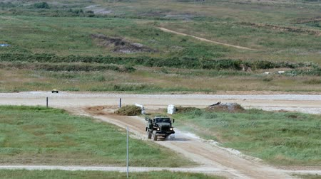 submachine : Alabino, Russia - 22 August 2017: Military Watering Machine rides on road. Special army car for the destruction of road dust.