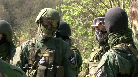 granada : Moscow, Russia - May 09, 2013: Airsoft team in military uniform with a weapon on background of forest. Sports game using a copy of a firearm.