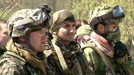 combate : Moscow, Russia - May 09, 2013: Airsoft team in military uniform with a weapon on background of forest. Sports game using a copy of a firearm.