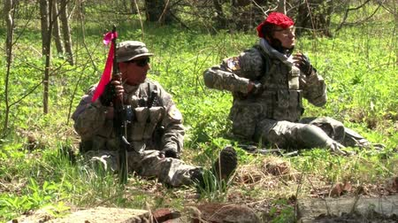 aim : Moscow, Russia - May 09, 2013: Airsoft game in the forest. People in military uniforms with weapons at the exercises.