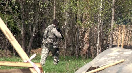 Moscow, Russia - May 09, 2013: Airsoft game with gun on military polygon. People in military uniforms using a copy of a firearm.
