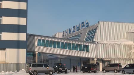 neglected : Chukotka, Russia. - 13 April 2013: People in Airport Anadyr city on far north. Cold snow town on edge of earth.
