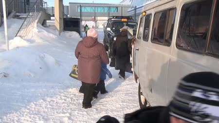 neglected : People in Airport Anadyr city on far north of Russia. Cold snow town on edge of earth.