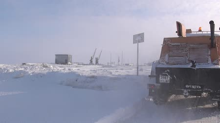mines : Chukotka, Russia. - 13 April 2013: Snow-removing machine cleans road in Anadyr city on far north. Cold snow town on edge of earth.